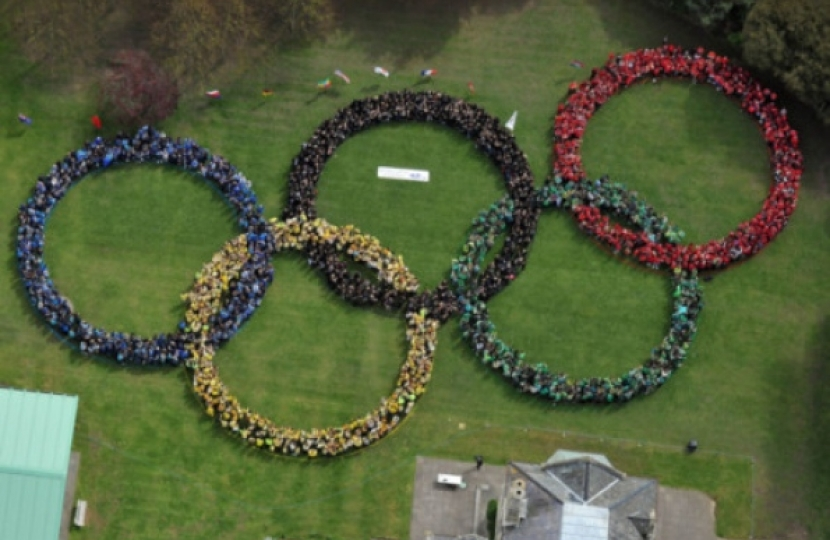 IMPRESSIVE Pupils and staff form the Olympic rings. Picture: Steve Reid